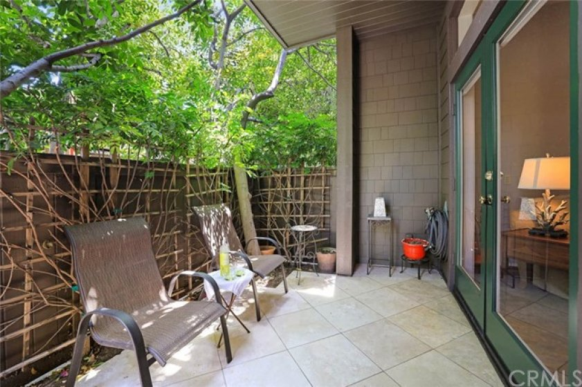 Beautiful French doors open wide to a delightful private patio.