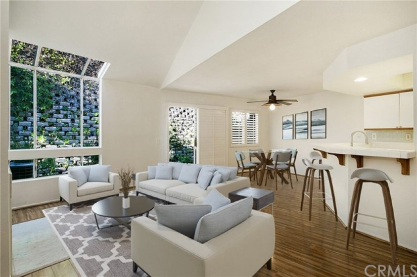 Welcoming Great room with access to outdoor patio. (room is virtually staged)