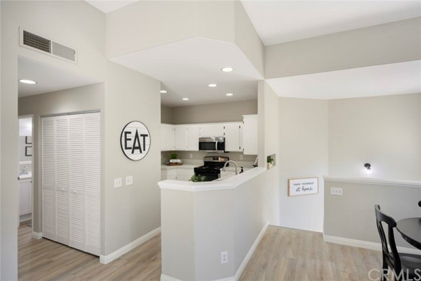 Kitchen and Dining Room are at the top of the stairs and are open to the Living Room!
