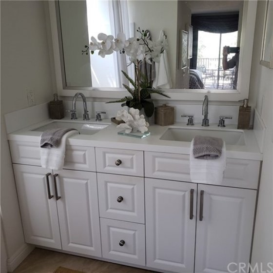 master bedroom bath has double sinks and a jacuzzi tub