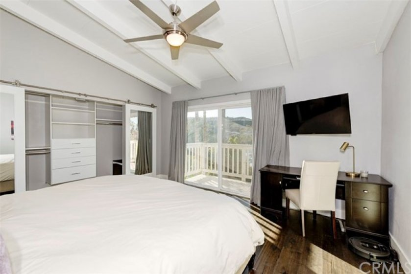 Master Bedroom featuring a good sized deck. Custom closets with mirrored barn doors.