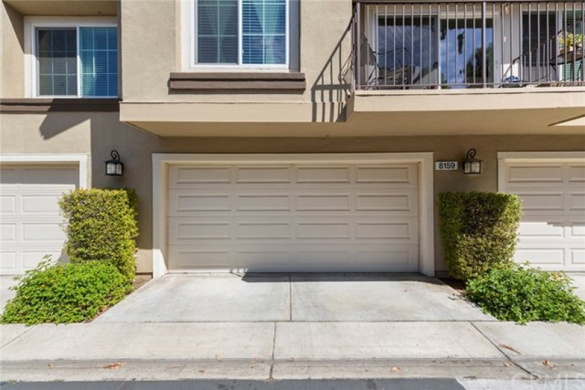Full two car garage with roll up door and opener- Direct access into the home with entry door through the laundry room-Storage cabinets installed in front and right side-