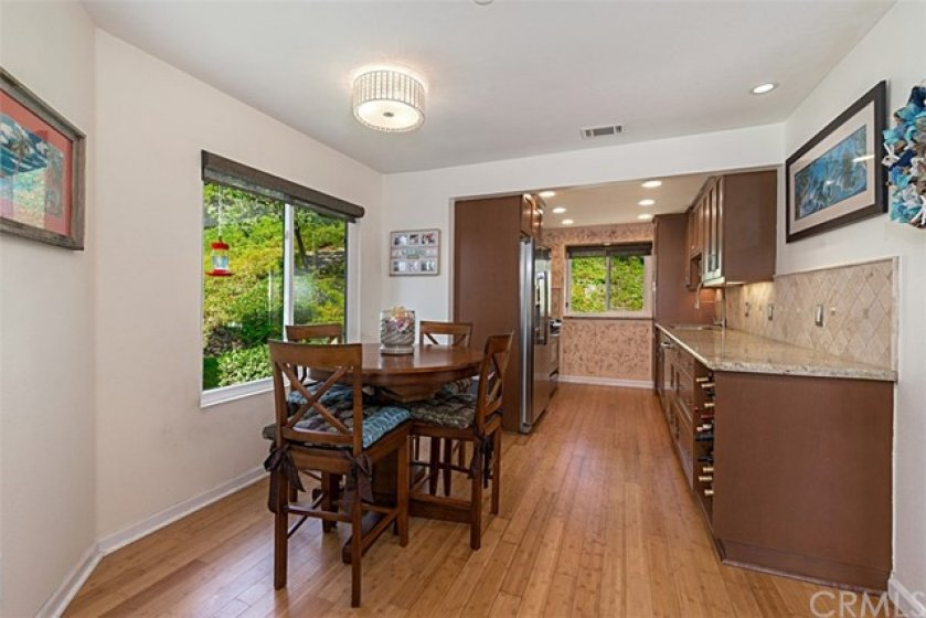 Dining area opens to kitchen, extra window being end unit allows in natural light!