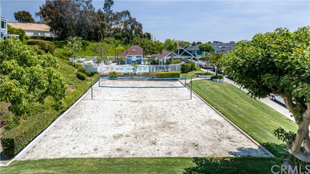 Sand volleyball court next to pool