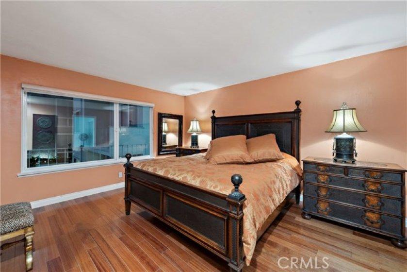 spacious master bedroom boasts ocean views