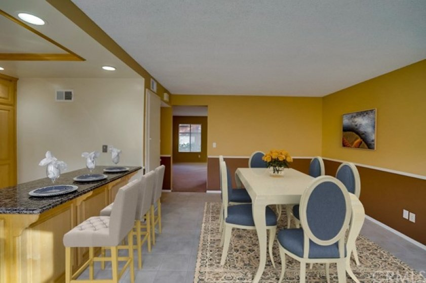 Large dining area offers flexibility to be used as a less formal living space as well (virtually staged)