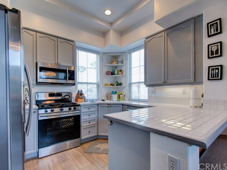 Bright, open kitchen with stainless appliances