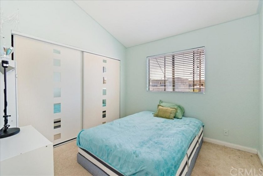 Cathedral ceilings and large closet in bedroom.