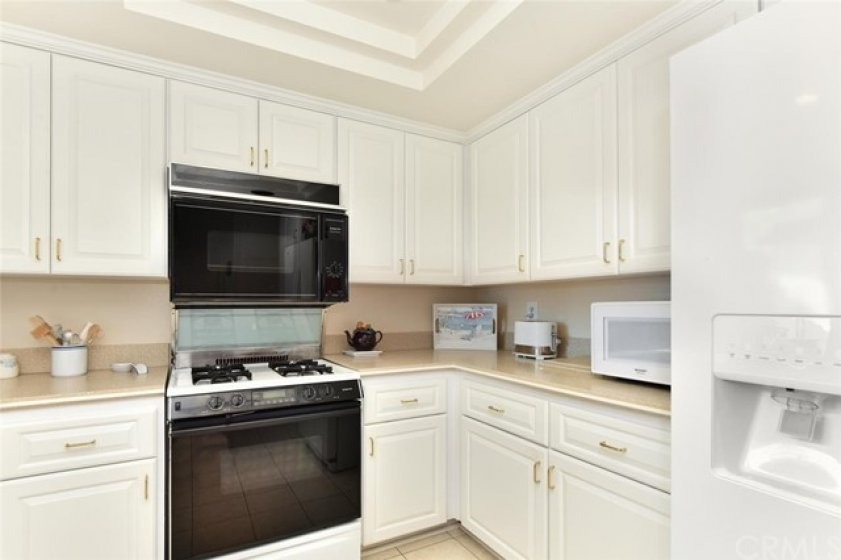 Remodeled kitchen with corian counters with an integrated corian sink.  Two ovens one convection