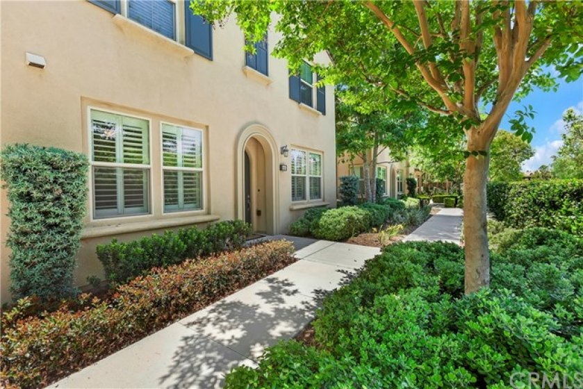 Quiet, lush entry walk. No units looking back at you across the walkway!