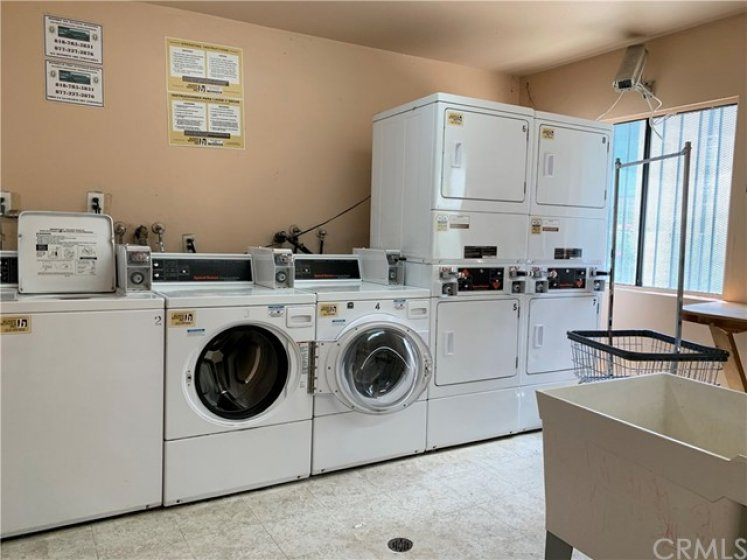 Laundry room located near condo entrance and the pool
