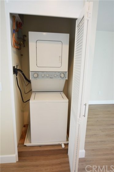Your in-house new washer and dryer next to the new tankless water heater.  Rarely found in other Laguna Lido condos.