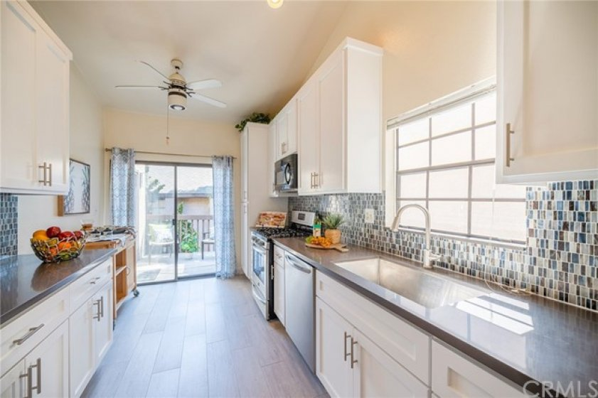 Remodeled kitchen with quartz counters, custom cabinetry, stainless steel appliances, and more!
