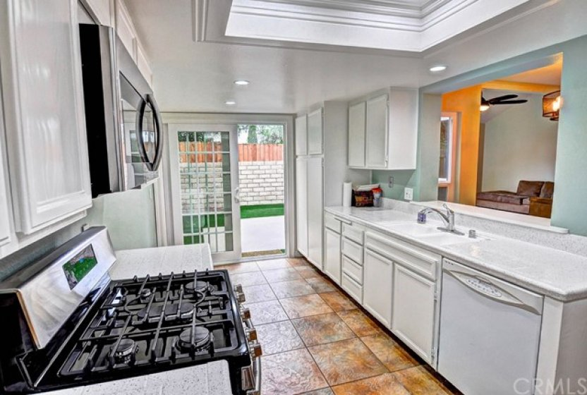 Kitchen with pass-through bar and access to the back yard.