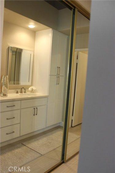 Masters Bathroom large mirrored closets.