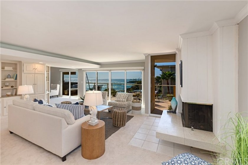 Living Room with a Sit-Down White Water Ocean View.  Raised Hearth Fireplace on the right.