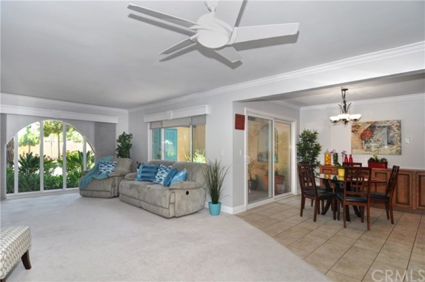 Open Concept Floorplan with Spacious Dining Room Open to Living Room & Kitchen and Slider to Private Patio