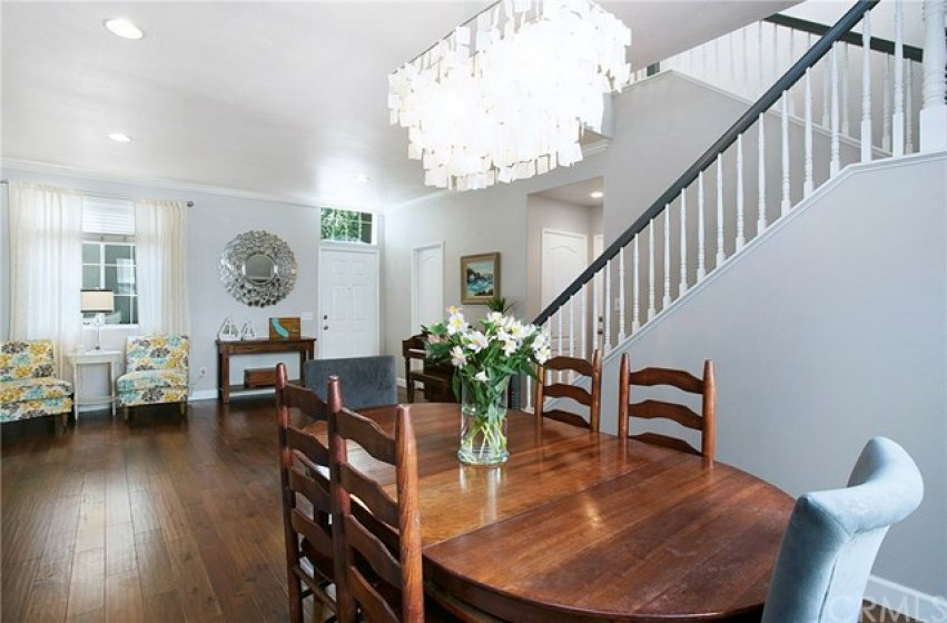Upgraded throughout including engineered hardwood floors and crown moulding