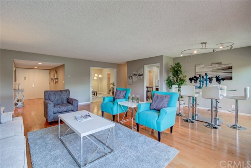 Open concept with foyer/living/dining and family room.
