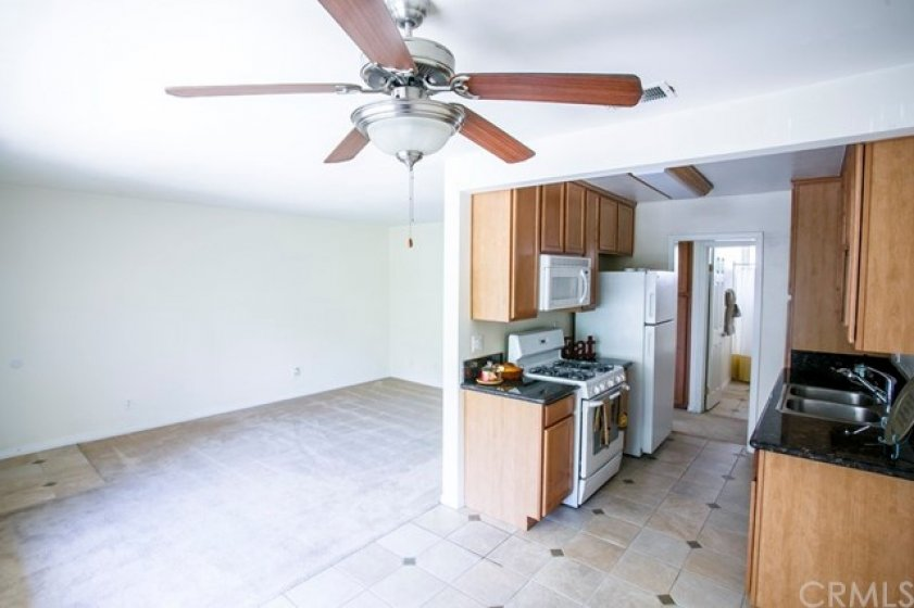 Plenty of  oak cabinets in the kitchen, granite counters & tiled floor. Fully equipped with gas range, microwave, dishwasher and refrigerator.