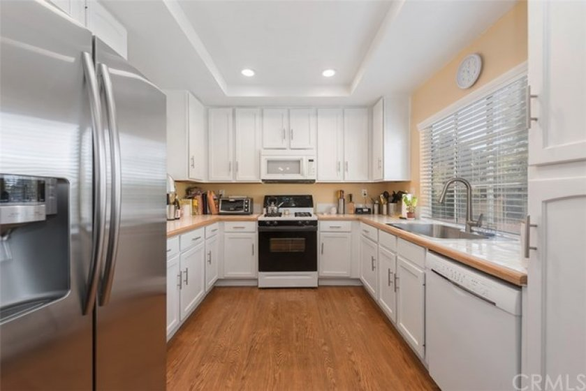 White cabinetry, tile countertops
