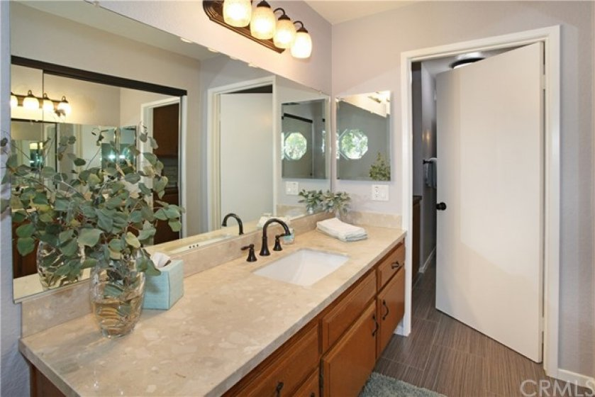 En suite bathroom to master bedroom. Jack & Jill tub with shower and toilet connects to vanity area off second bedroom