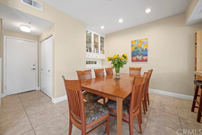 The dining room is adjacent to the kitchen and living room. There are built-ins within the dining room for storage. A laundry closet is right by the entrance to the direct access garage.
