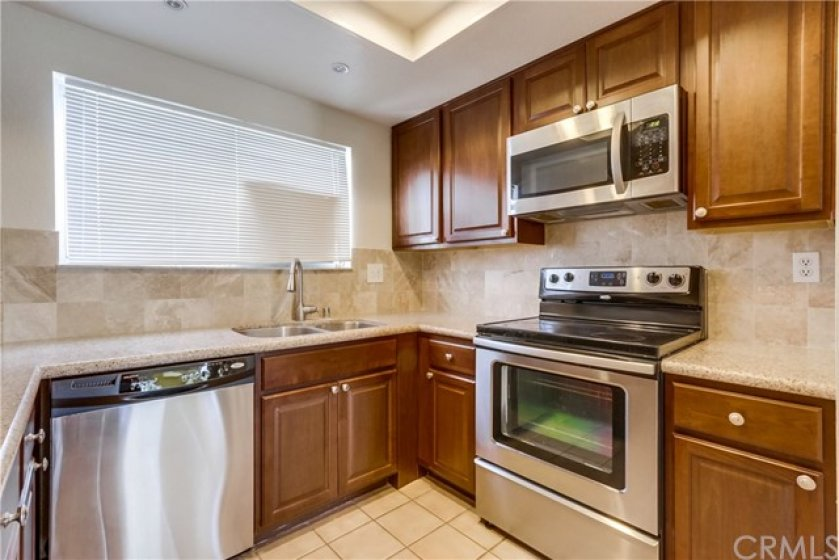 Kitchen has stainless steel appliances