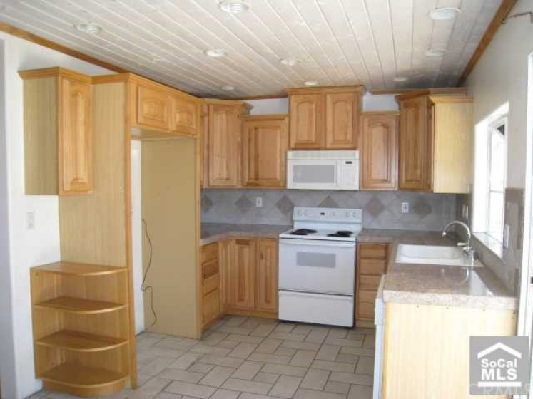 Kitchen - granite counters, stove,dishwasher and canned lighting