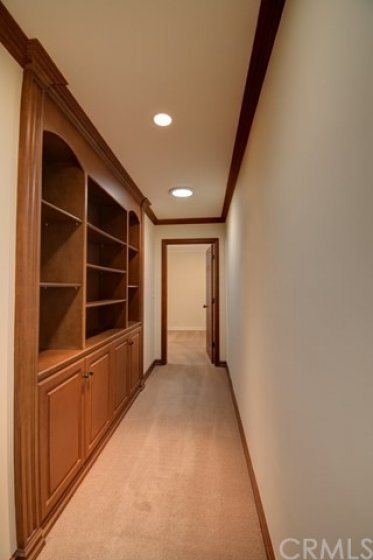 Hallway to master suite with more custom cabinetry