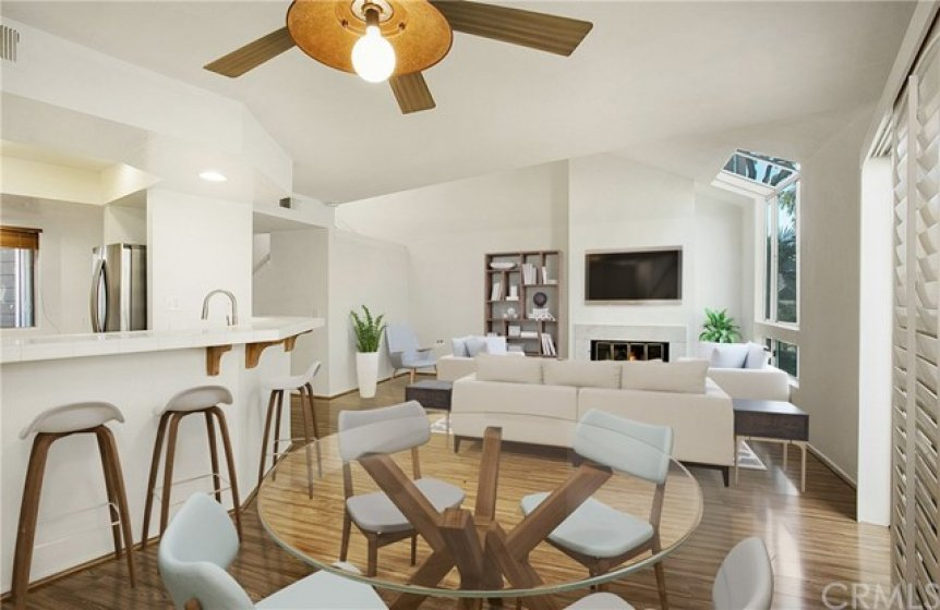 Lovely dining area open to living space and kitchen. (Room is virtually staged)