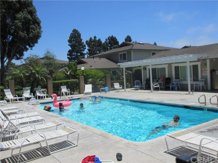 Solar heated pool and Club house in the community, steps away from the home