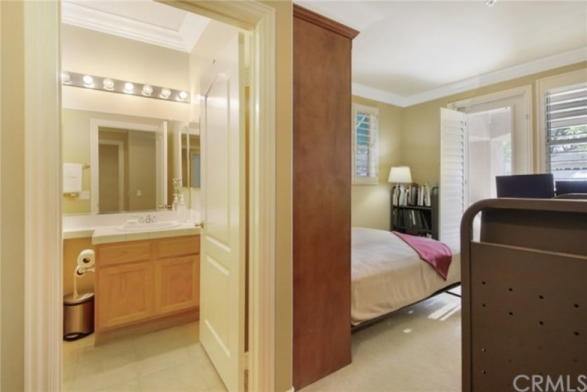 Downstairs bedroom with full bath, second large walk-in closet and walk out patio.