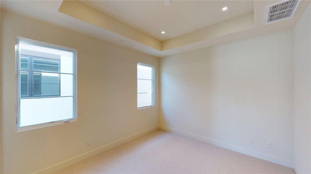 Secondary bedroom 2 has a en-suite bath and walk in closet.