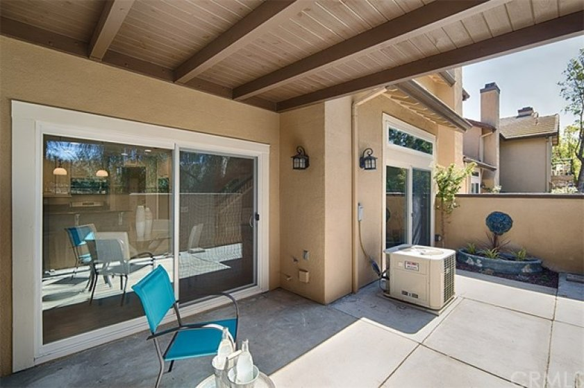 Easy care backyard with covered patio.