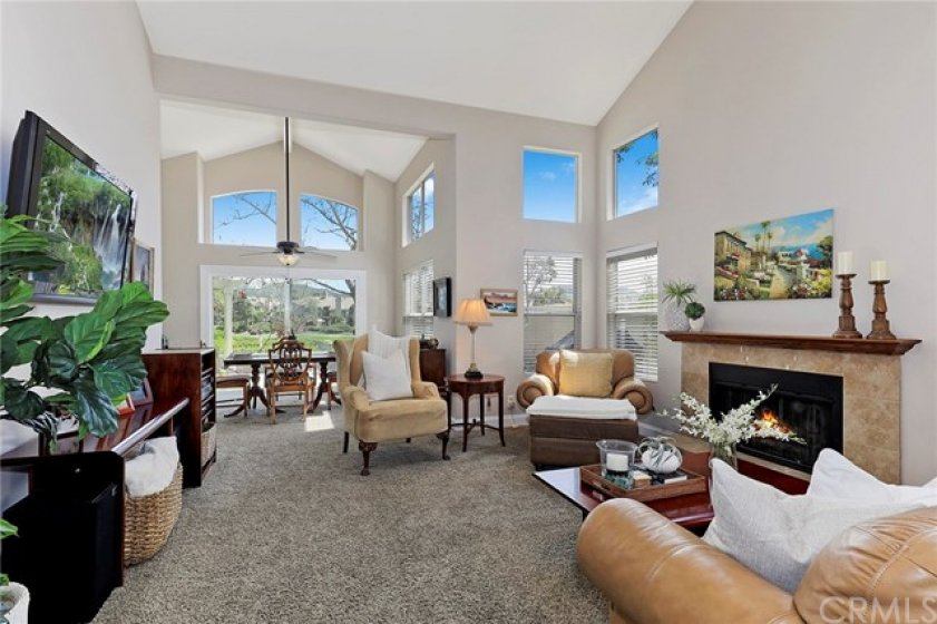 Beautiful Living Room and Dining Room with vaulted ceilings and view of the golf course!