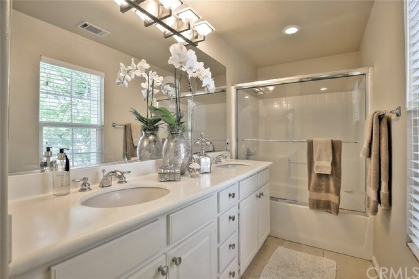 Elegant Master Bath with Double Sinks, New Glass Enclosure