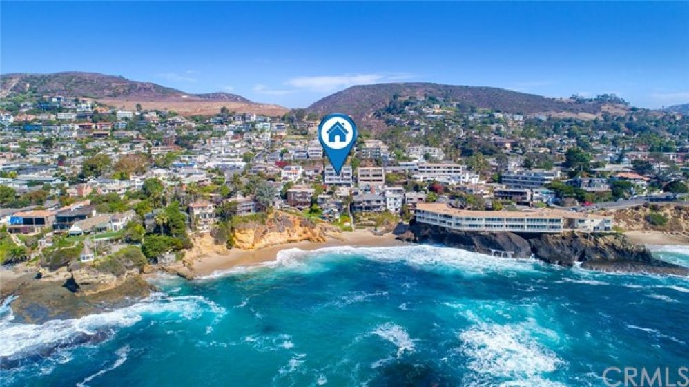 Located in a building with just nine other units on the ocean side of Pacific Coast Highway in prestigious North Laguna—second row from the water.