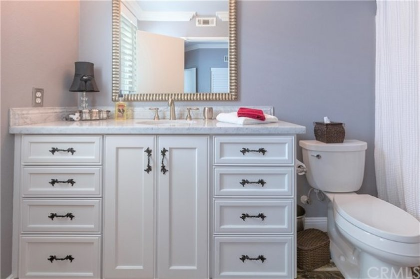 Guest bathroom with shower over tub