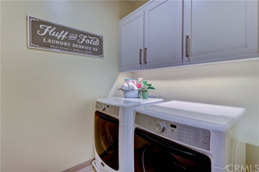 Easy Access From Bedrooms to the 2nd Floor Dedicated Laundry Room. Great Storage Cabinets. Room to Fluff and Fold! (High End W/D Negotiable.)