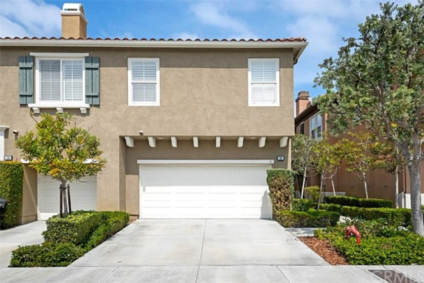 Generous long drive way leads to two car attached garage and provides off street parking.  There are also multiple guest parking slots very close by.