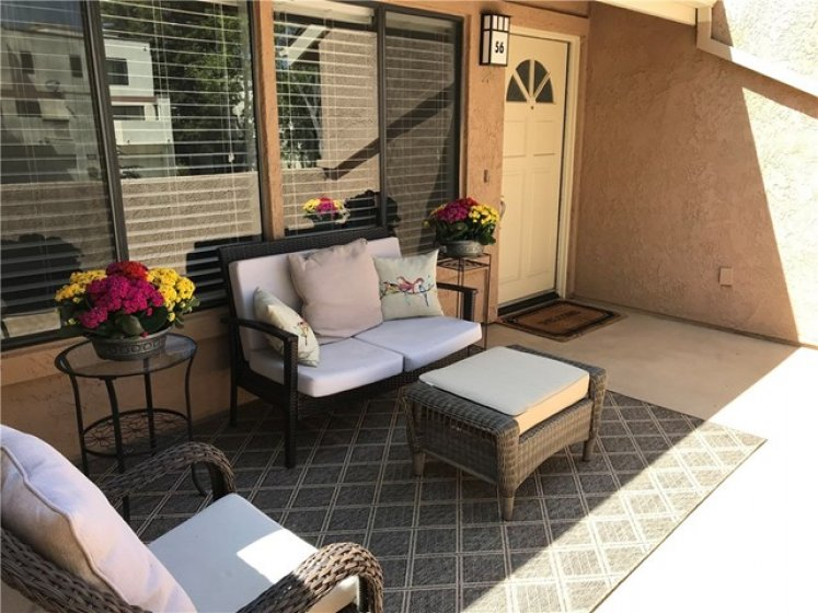 Spacious Front Patio/Deck. This is so spacious you can have a dining table plus sofa and chair. Great Outdoor Seating Area with Peaceful View.