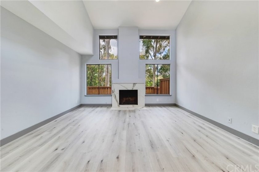 Living area: exquisitely done fireplace, new flooring, and paint.