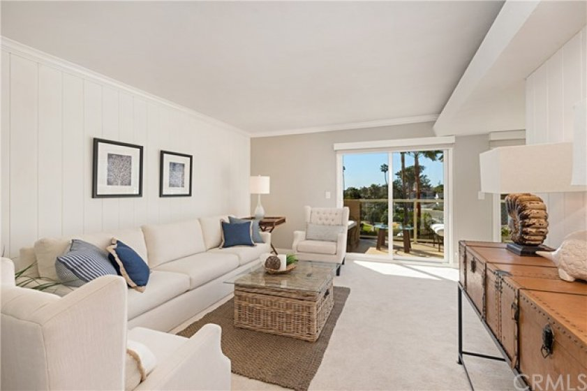 Spacious third bedroom (or Den) with sliding glass doors to the front ocean view deck.
