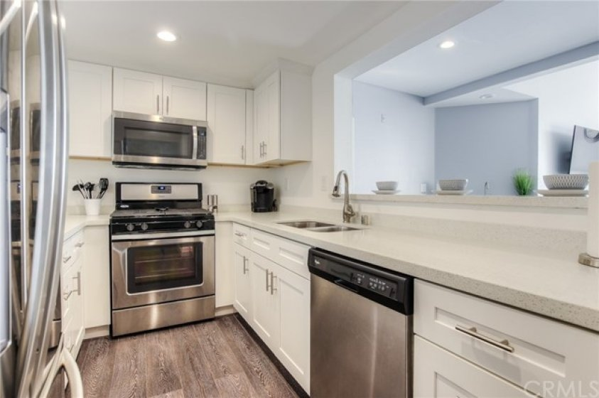 Fully redesigned kitchen! All NEW appliances, NEW Stove, NEW microwave, NEW dishwasher, NEW fixtures, NEW soft closing cabinets & drawers, NEW flooring