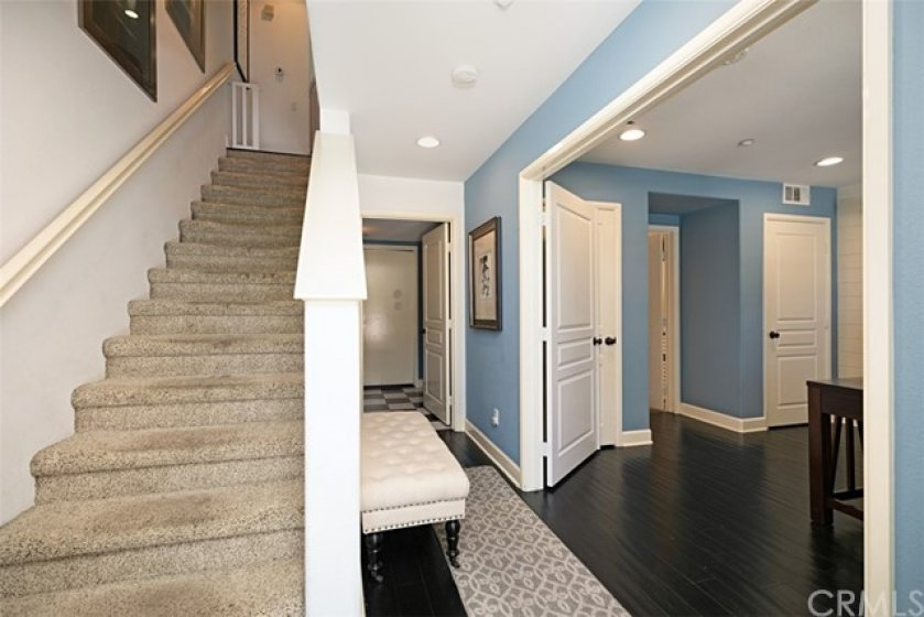Entry with direct access to laundry room and garage, first floor bedroom and full bathroom.