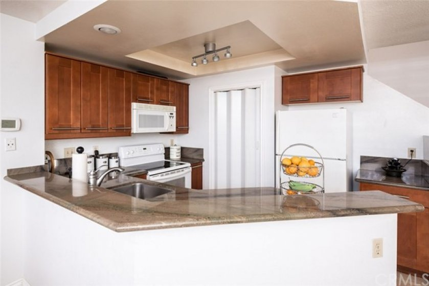 Newer Cabinets with multi color Granite Countertops and Custom lighting