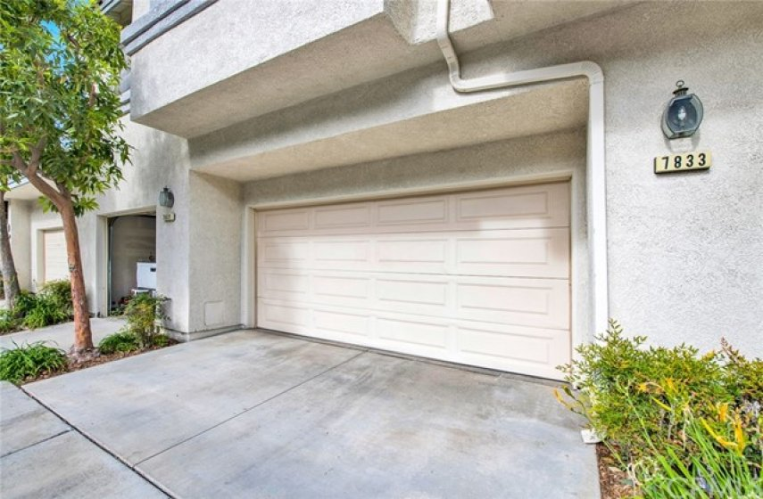 Two car attached garage offers direct access to home