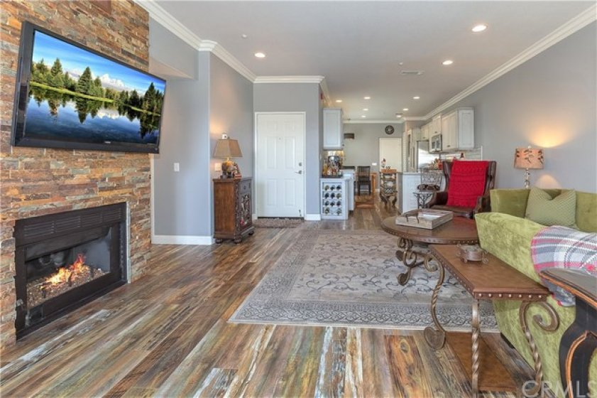Cozy fireplace you can actually enjoy with TV mounted above and media built-ins adjacent.  Lovely!