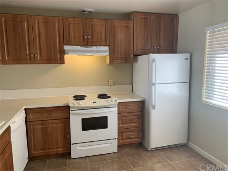 Electric Range, Dishwasher, Refrigerator and Range Hood.  Beautiful Cabinetry.